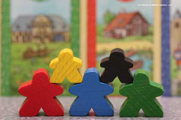 Cardcassonne meeples posing in front of their houses